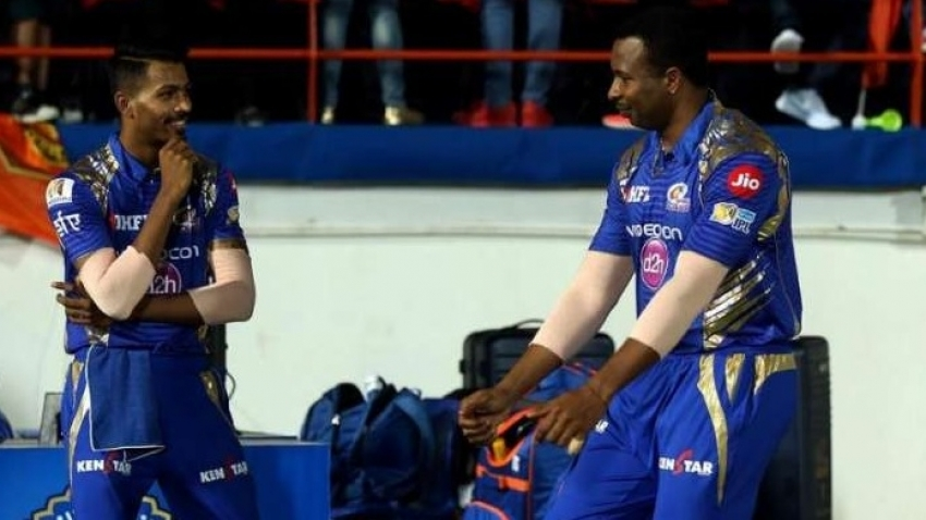 Pollard commiserates with teammate Hardik Pandya after loss to Royals