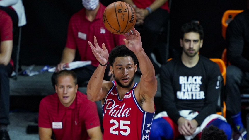76ers star Simmons dislocated kneecap, facing several weeks out
