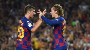 Griezmann opens Barcelona account against Betis
