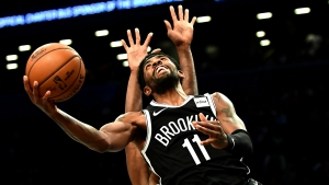 Irving scores 50 points in record-setting debut but Nets lose in OT