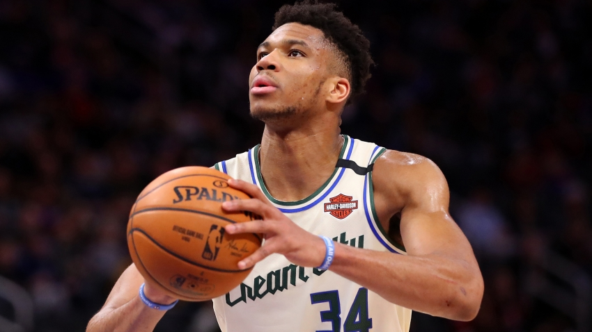 Antetokounmpo stars for Bucks, Rockets crush Warriors