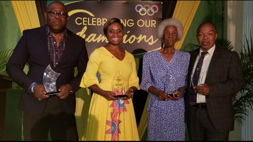 Four receive special honours, Olympians pinned at annual dinner