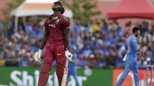 West Indies' Carlos Brathwaite reacts after being caught and bowled by India's Krunal Pandya during the first Twenty20 international cricket match, Saturday, Aug. 3, 2019, in Lauderhill, Fort Lauderdale.