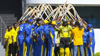 Jamaica Scorpions captain Chris Gayle is all smiles as he gets a guard of honour from teammates and Barbados Pride