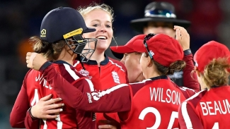 England women celebrate a Pakistan wicket during their ICC Women's T20 World Cup Group B match in Canberra, Australia.
