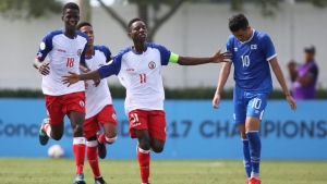Haiti captain Fredler Christophe celebrates a goal.