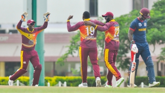 "Sheldon Cottrell (centre) celebrates Kyle Corbin's dismissal with Devon Thomas and Chesney Hughes  during the Group ""B"" match of the WINDIES Super50 Cup between Combined Campuses and Colleges Marooners and Leeward Islands Hurricanes on Monday, October 8, 2018 at 3Ws Oval."