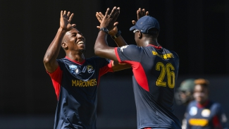 Jermaine Levy high fives Carlos Brathwaite  during the Grand Final of the Super50 Cup between Guyana Jaguars and Combined Campuses & Colleges Marooners.