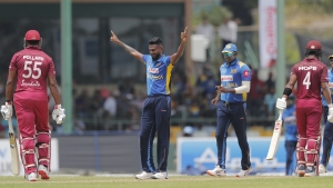 Sri Lanka's Isuru Udana, second right, celebrates the wicket of West Indies' Kieron Pollard, left, during their first one day international cricket match in Colombo, Sri Lanka, Saturday, Feb. 22, 2020.