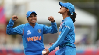 Radha Yadav of India (R) is congratulated by teammate Veda Krishnamurthy after the dismissal of Rachel Priest of New Zealand during the ICC Women's T20 Cricket World Cup match between India and New Zealand at Junction Oval on February 27, 2020.