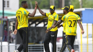 "Oshane Thomas and Rovman Powell celebrate the dismissal Monank Patel  during the Group ""B"" match of the WINDIES Super50 Cup between Jamaica Scorpions and United States of America on Monday, October 8, 2018 at Kensington Oval."