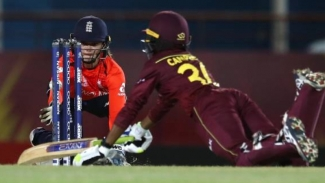 Amy Jones of England looks to run out Shemaine Campbelle of West Indies during the ICC Women's World T20 at Darren Sammy Cricket Ground on Sunday.