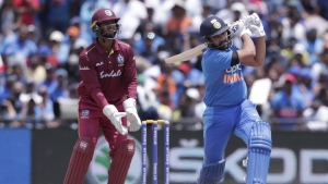 India's Rohit Sharma watches before being caught out by West Indies' Kieron Pollard off the bowling of Sunil Narine during the first Twenty20 international cricket match, Saturday, Aug. 3, 2019, in Lauderhill, Fla. At left is West Indies wicket keeper Nicholas Pooran. India won by four wickets.