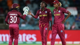 Stafanie Taylor of the West Indies has a muted celebration with teammates after taking the wicket of Javeria Khan of Pakistan during the ICC Women's T20 Cricket World Cup match between the West Indies and Pakistan at Manuka Oval on February 26, 2020.
