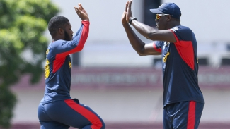 "Yannick Ottley and Carlos Brathwaite celebrate the dismissal of Jermaine Blackwood during the Group ""B"" match of the CWI Super50 Cup."